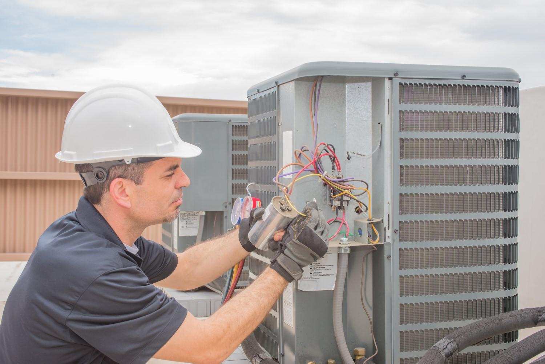 Man repairing AC unit
