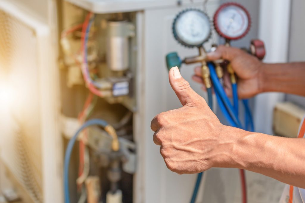 Repairman doing a thumbs up